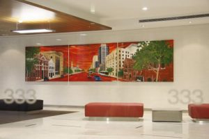 Photograph of a large triptich painting of a city scene in the Foyer of 333 Ann Street, Brisbane