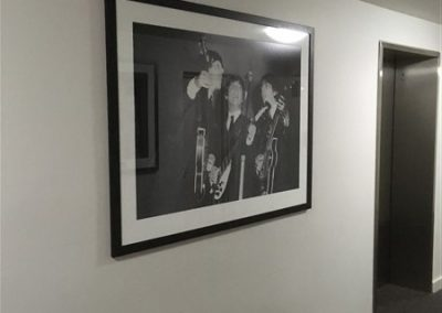 Photograph of the lift Lobby of the Festival Towers showing a framed photograph of The Beatles during 'The Beatles 1964 World Tour'